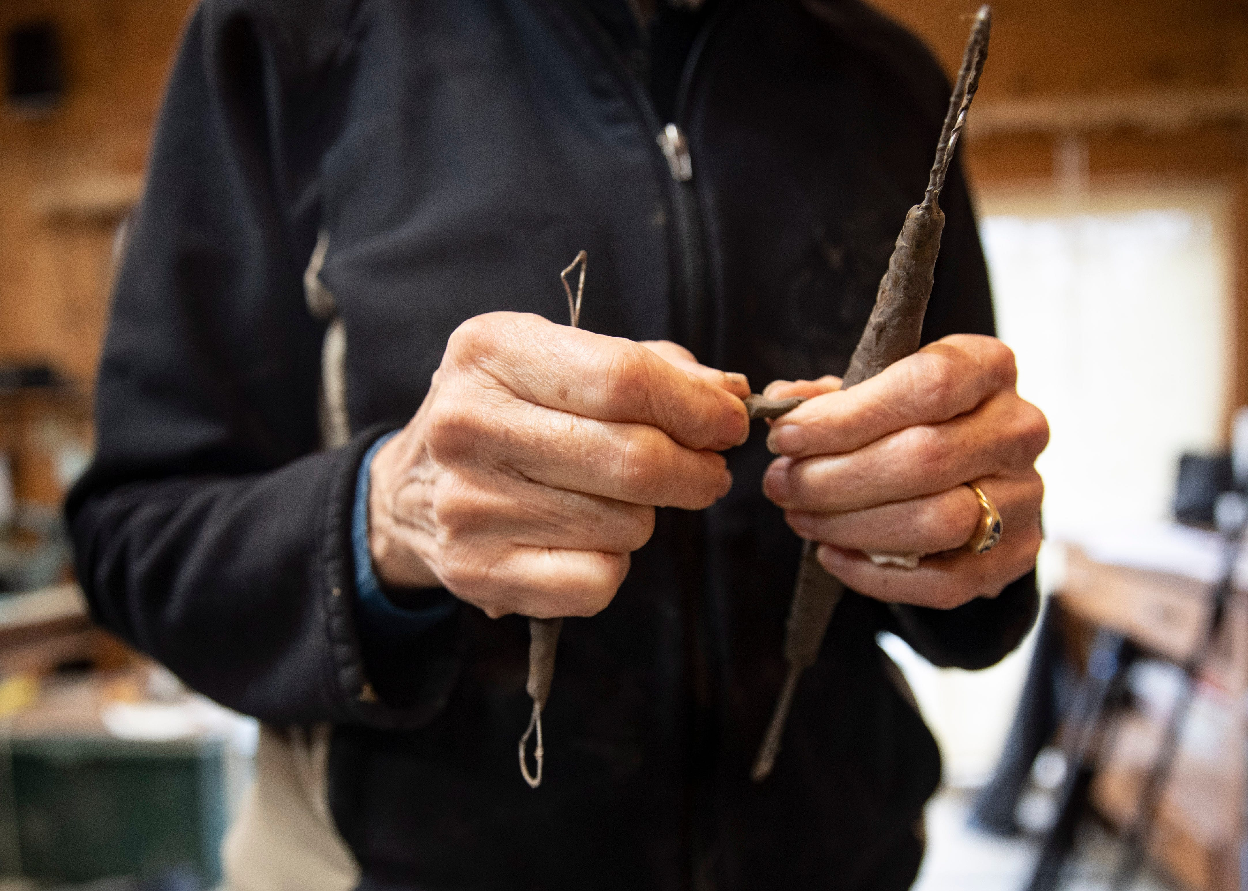 Andrea Lugar of the Lugar Bronze Foundry in Eads, Tenn.,  holds the tools she uses to sculpt the statue of Ida B. Wells, the African American civil rights advocate and journalist who fought against racism, segregation and lynching, at her home studio on Friday, March 15, 2021.
