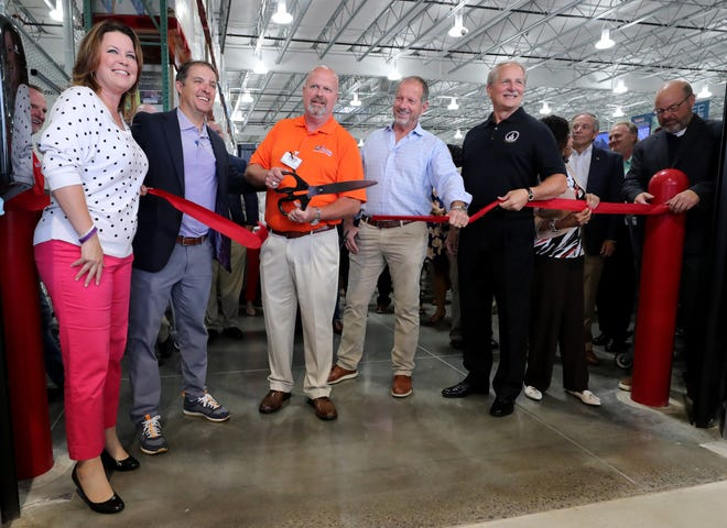 """The Murfreesboro Costco store manager, Chris Harman, center, cuts the ribbon-cutting for the new Murfreesboro Costco location on Tuesday, July 20, 2021. From left to right Kelli Beam with the Rutherford County Chamber of Commerce, Murfreesboro Mayor Shane McFarland, Murfreesboro Costco store manager, Chris Harman, Charles """"Mickey"""" Mitchell and Rutherford County Mayor Bill Ketron, right."""