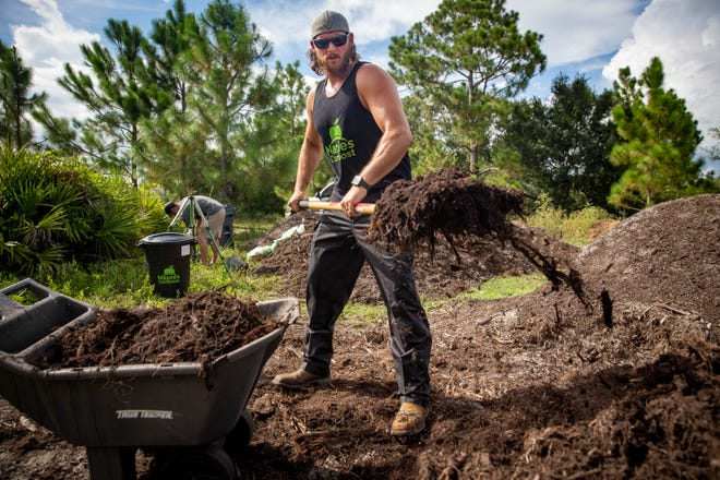 Naples Compost owner Joe Rauktys tends to his compost pile, Friday, July 16, 2021, at their home in Golden Gate Estates.