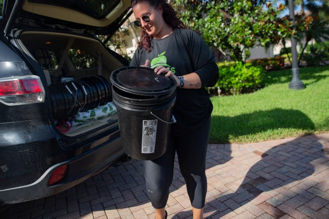 Naples Compost owner Amanda Rauktys collects compost from a client, Tuesday, July 13, 2021, in North Naples.