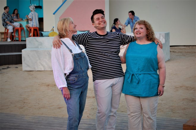 """Margaret Clair, left, Nick Drivas and Tina Edlin are featured in a scene from """"Mama Mia!"""" continuing this week at the Lions Wilderness Park Amphitheater in Farmington."""