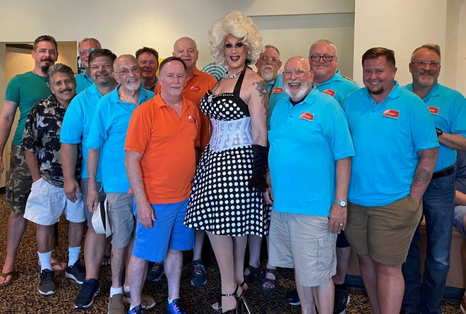 """Members of the Palm Springs Gay Men's Chorus pose with local drag talent Rosemary Galore at an """"All Summer Long Snazzy Sassy Songsational Summerific Sing-A-Long"""" event at the Palm Springs Cultural Center"""