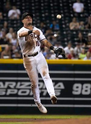 Jul 19, 2021; Phoenix, Arizona, USA; Arizona Diamondbacks third baseman Josh Rojas (10) throws off balance for an out against the Pittsburgh Pirates in the fourth inning at Chase Field. Mandatory Credit: Rick Scuteri-USA TODAY Sports