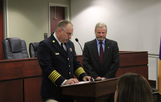 York City Fire Chief William Sleeger Jr. (left) speaks at a swearing-in ceremony Monday, July 19, 2021, as York City Mayor Michael Helfrich (right) listens.