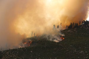 The Tamarack Fire is seen approaching Highway 88 near Woodfords in Alpine County on July 20, 2021.