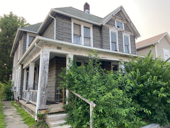 If a zoning change is approved, the building that houses 122 and 124 N. Seventh St. would be razed to provide additional parking for Best One Tire.