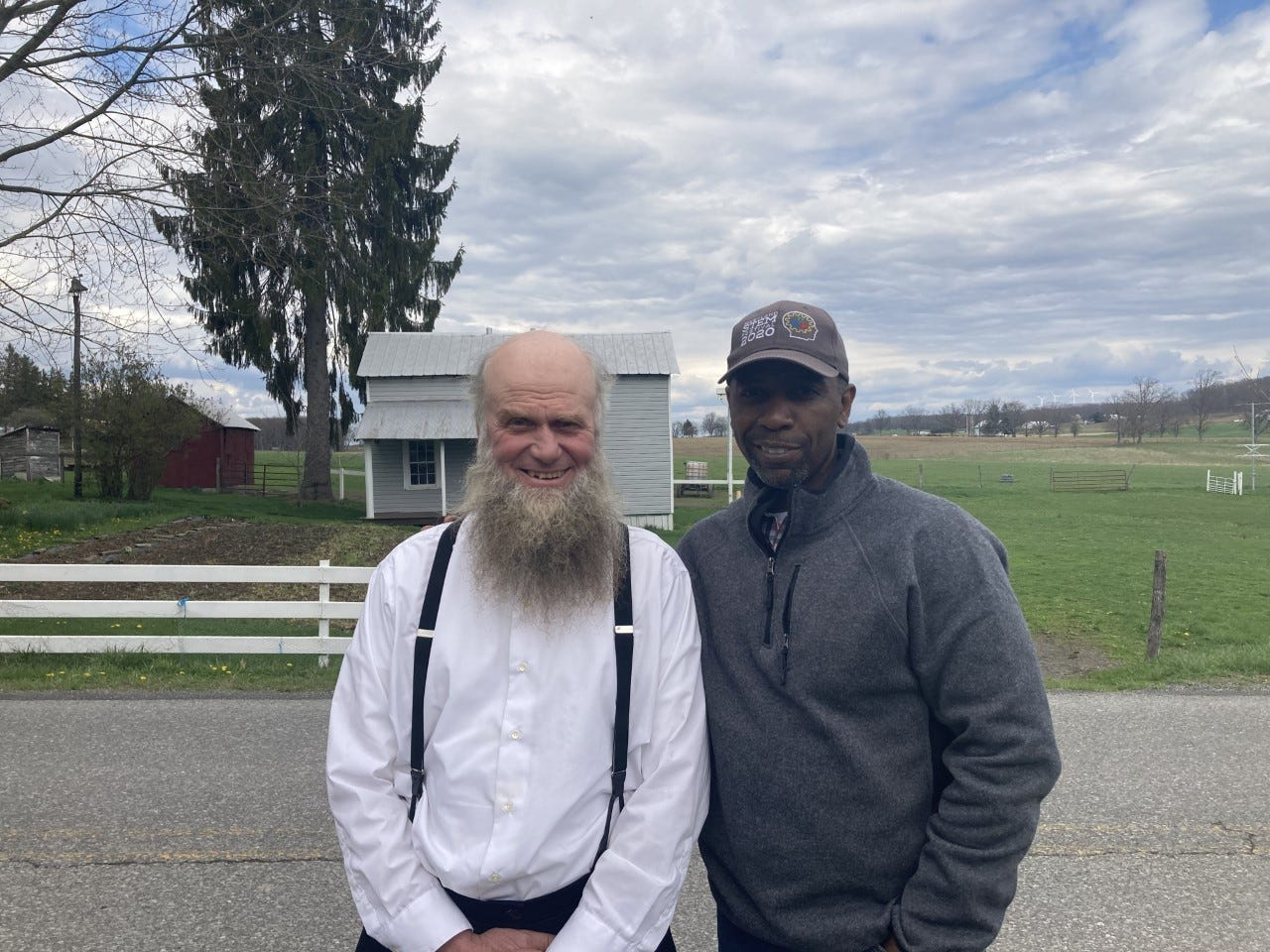 Sam Yoder, the Amish farmer on whose property the former church now sits, poses for a photograph with NAACP Maryland State Conference President Willie Flowers.