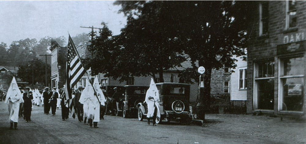 Hooded Klansmen march through Oakland in this 1925 image.