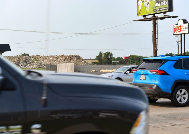 A construction site is visible as traffic passes on West 12th Street on Tuesday, July 20, 2021 in Sioux Falls.