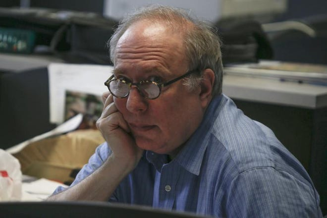 In this photo from June 12, 2014, Associated Press writer Kevin Begos looks up from a terminal while writing at the bureau in Pittsburgh. Begos later became mayor of Apalachicola.