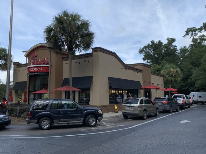 A line wrapped around the building of the Apalachee Parkway Chick-Fil-A. This location will serve its last customer Friday.