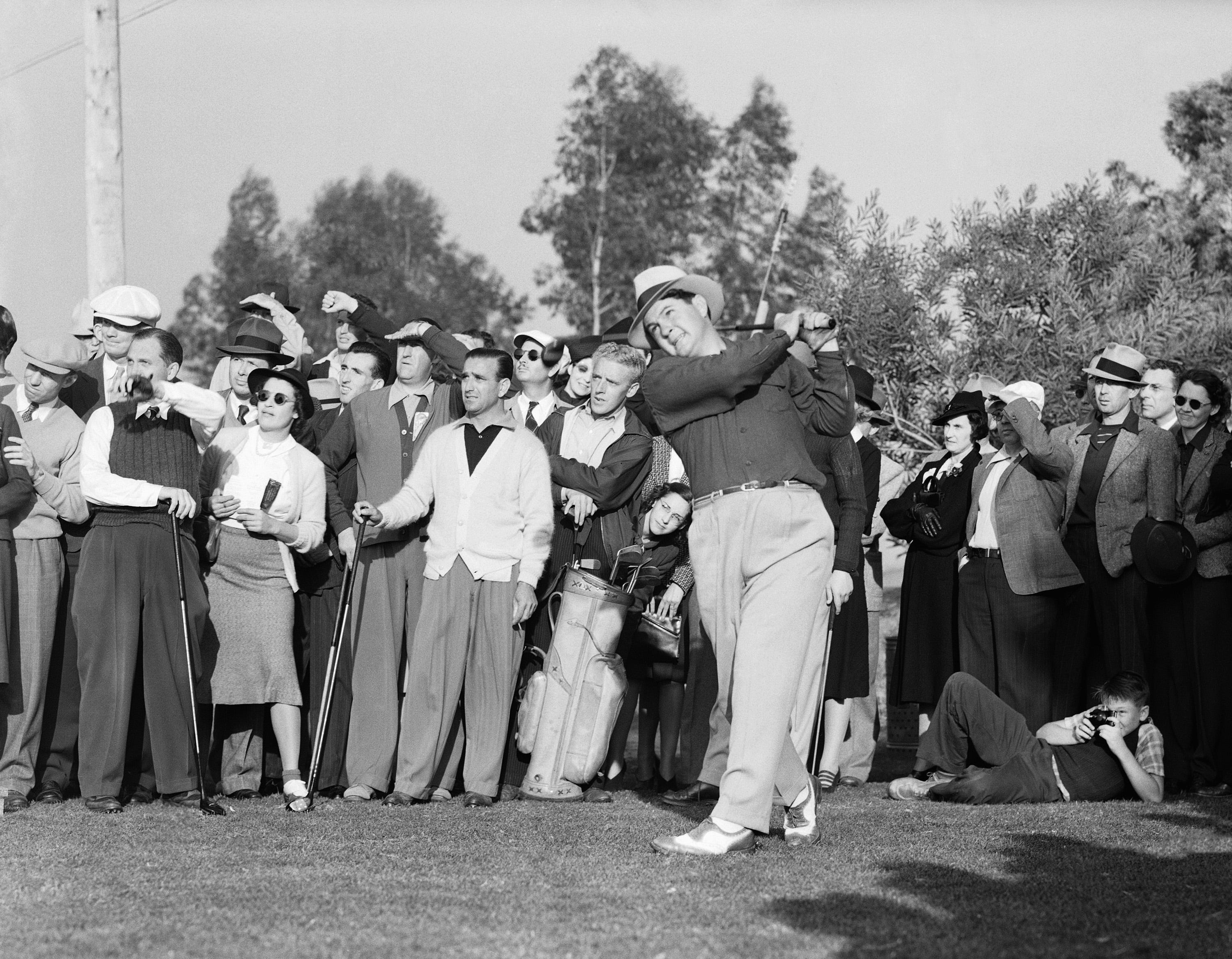 """Ed """"Porky"""" Oliver on Jan.28,1940 in Hornell, N.Y., shown driving on the 18th Tee, captured his first major golf prize by winning the fourth annual $3,000 Bing Crosby Golf Tournament with a 36-hole score of 68-67--135. He collected $500 top money for his 9-under-par performance."""