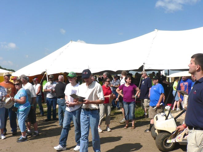 """After perusing an exhibit tent, the question is """"where to go next?"""" There are over 500 exhibitors in Tent city."""