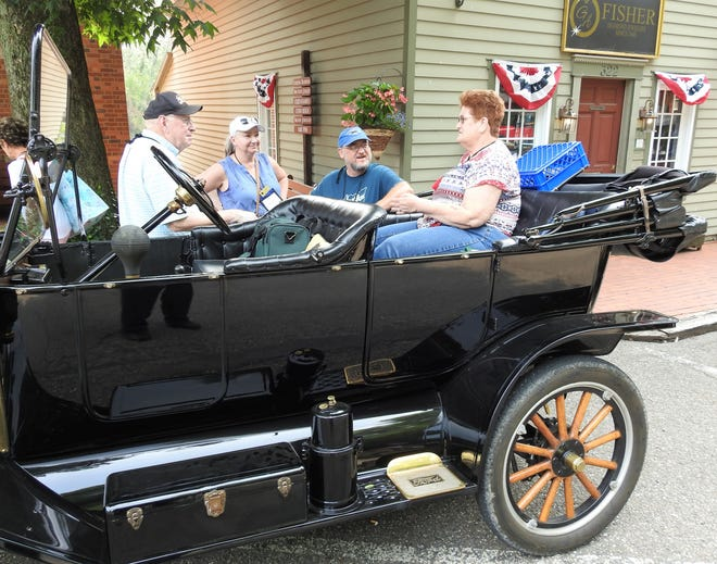 Dan Killecut, Sue and Jim Cook and Carol Mannherz talk during a visit by the International Model T Club on Tuesday to Roscoe Village. More than 230 cars and 500 members are touring the region this week while staying in the New Philadelphia and Dover area.