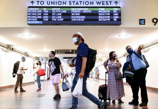 People wear face coverings as they pass through Union Station on July 19, 2021 in Los Angeles,. A new mask mandate went into effect just before midnight on July 17 in Los Angeles County requiring all people, regardless of vaccination status, to wear a face covering in public indoor spaces amid a troubling rise in COVID-19 cases.