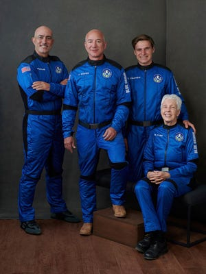 The members of the first Blue Origin spaceflight crew, from left: Mark Bezos, brother of Jeff Bezos; Jeff Bezos, founder of Amazon and space tourism company Blue Origin; Oliver Daemen of the Netherlands; and Wally Funk, aviation pioneer from Texas.