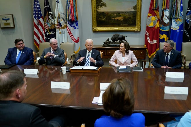 President Joe Biden, center, speaks during a meeting with a bipartisan group of governors and mayors and cabinet officials in the Roosevelt room of the White House in Washington on July 14, 2021, to discuss the bipartisan infrastructure deal in the Senate. Biden is flanked by New Jersey Gov. Phil Murphy, left, and Vice President Kamala Harris, right.