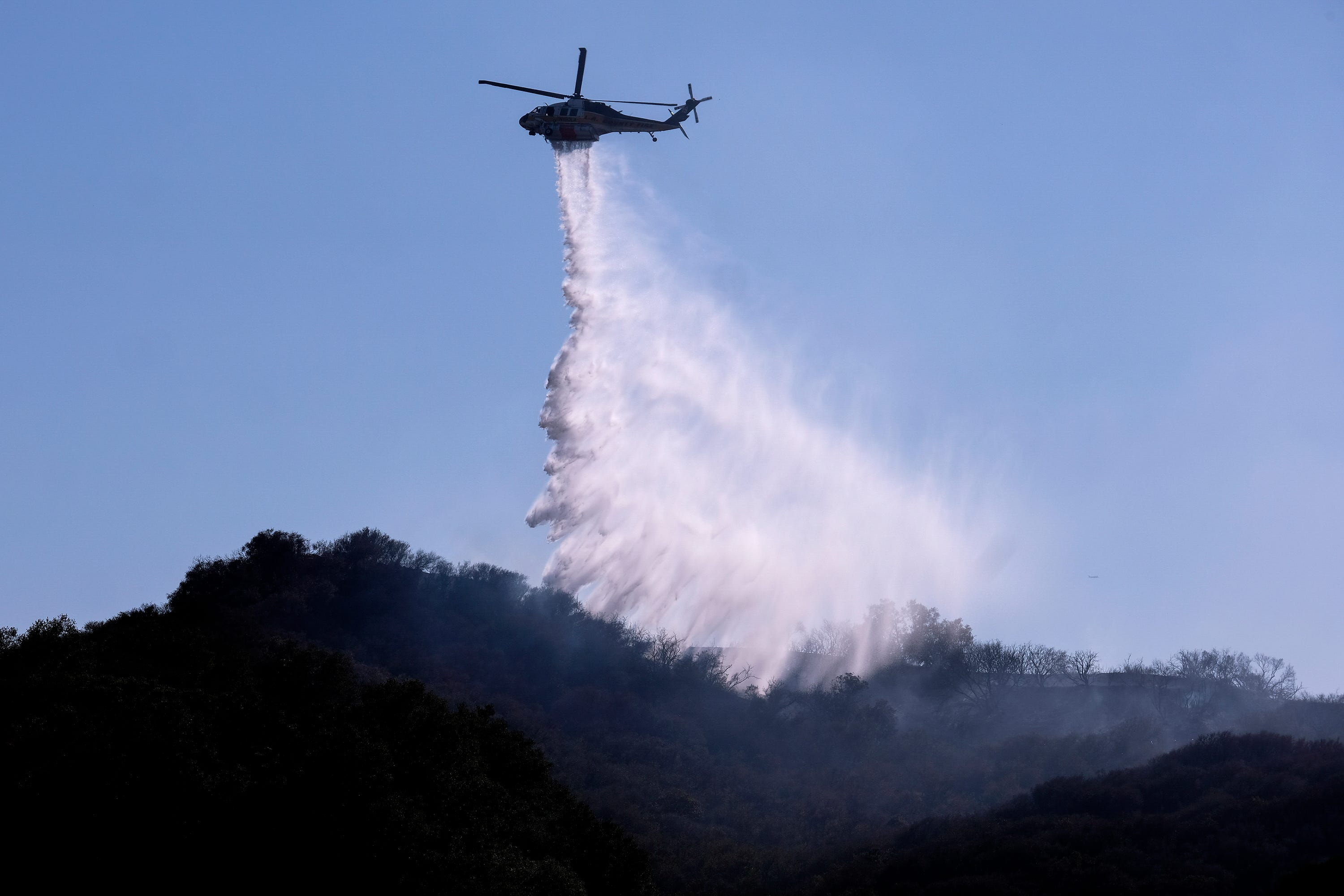California's Dixie Fire explodes to 'megafire' status as western wildfires continue to rage