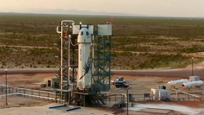 The Blue Origin rocket takes off