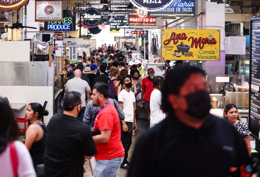 People gather in Grand Central Market on July 19, 2021 in Los Angeles. A new mask mandate went into effect just before midnight on July 17th in Los Angeles County requiring all people, regardless of vaccination status, to wear a face covering in public indoor spaces amid a troubling rise in COVID-19 cases.
