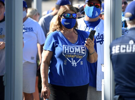 Fans wearing masks enter Dodger Stadium on July 19, 2021 for a game between the Los Angeles Dodgers and the San Francisco Giants.