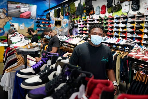 Shoppers wear masks inside of 'The Cool' store, Monday, July 19, 2021, in the Fairfax district of Los Angeles. Los Angeles County has reinstated an indoor mask mandate due to rising COVID-19 cases.