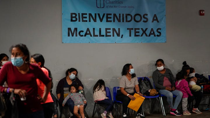 Jul 13, 2021; McAllen, Texas, USA; Catholic Charities of the Rio Grande Valley helps migrants with travel and other needs after crossing over into the U.S. The Respite Center in McAllen, Texas, is seeing about 800 migrants a day. Mandatory Credit: Jack Gruber-USA TODAY [Via MerlinFTP Drop]