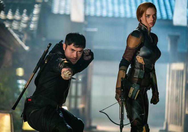 """Snake Eyes (Henry Golding) fights alongside Scarlett (Samara Weaving), a member of the G.I. Joe team, in """"Snake Eyes."""""""