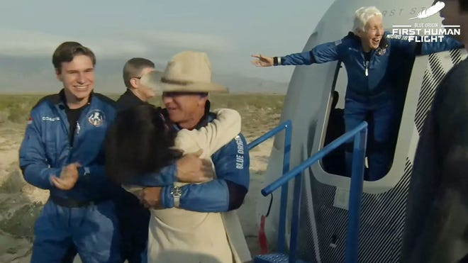This still image taken from video by Blue Origin shows Jeff Bezos(C), Wally Funk(R) and Oliver Daemen(L) after Blue Origin's reusable New Shepard craft capsule returned from space, safely landing on July 20, 2021, in Van Horn, Texas.
