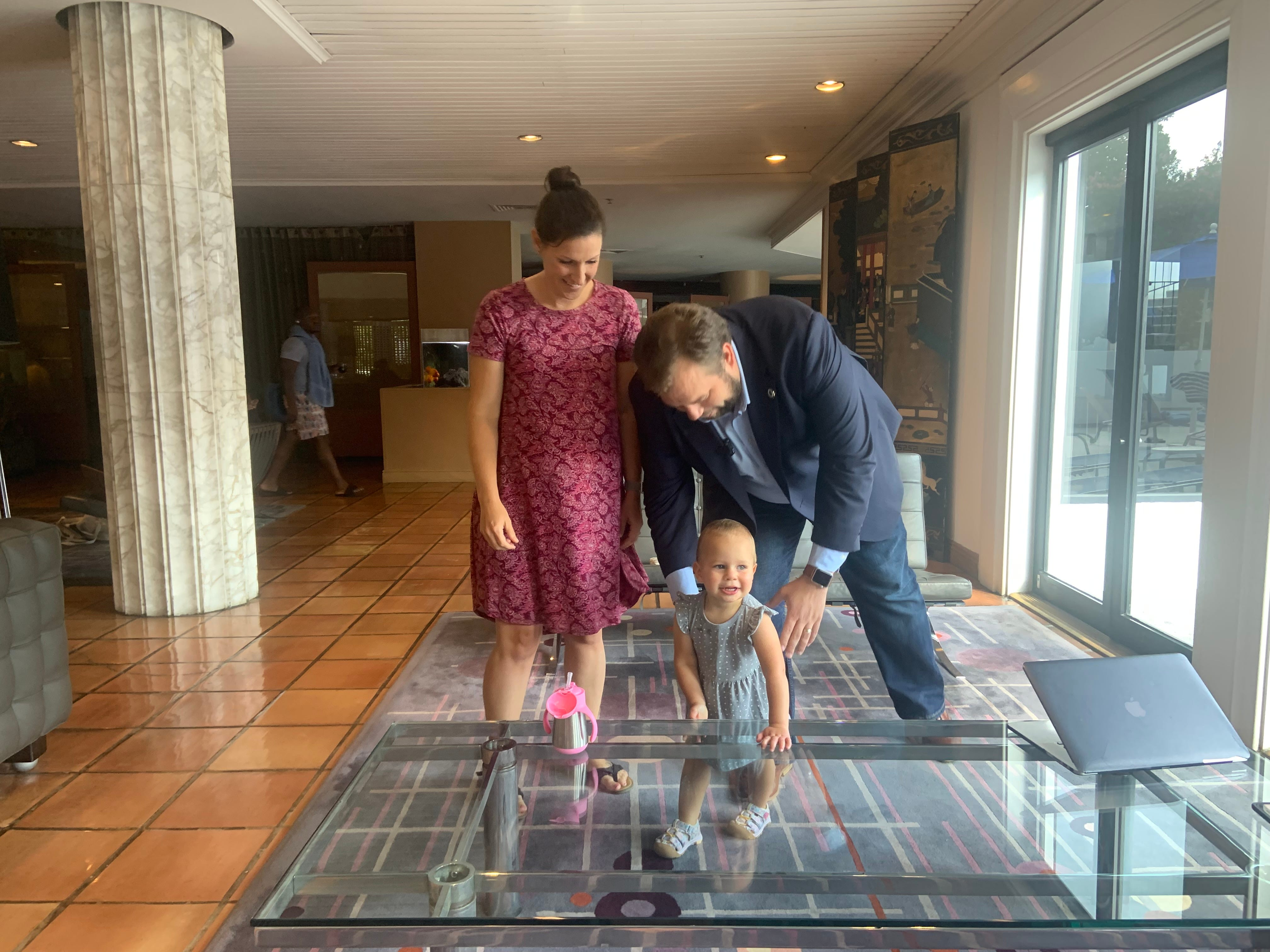 State Rep. John Bucy, D-Austin, stands in the lobby of a Washington hotel with his daughter, Bradley, and wife, Molly, on Friday, July 16, 2021.