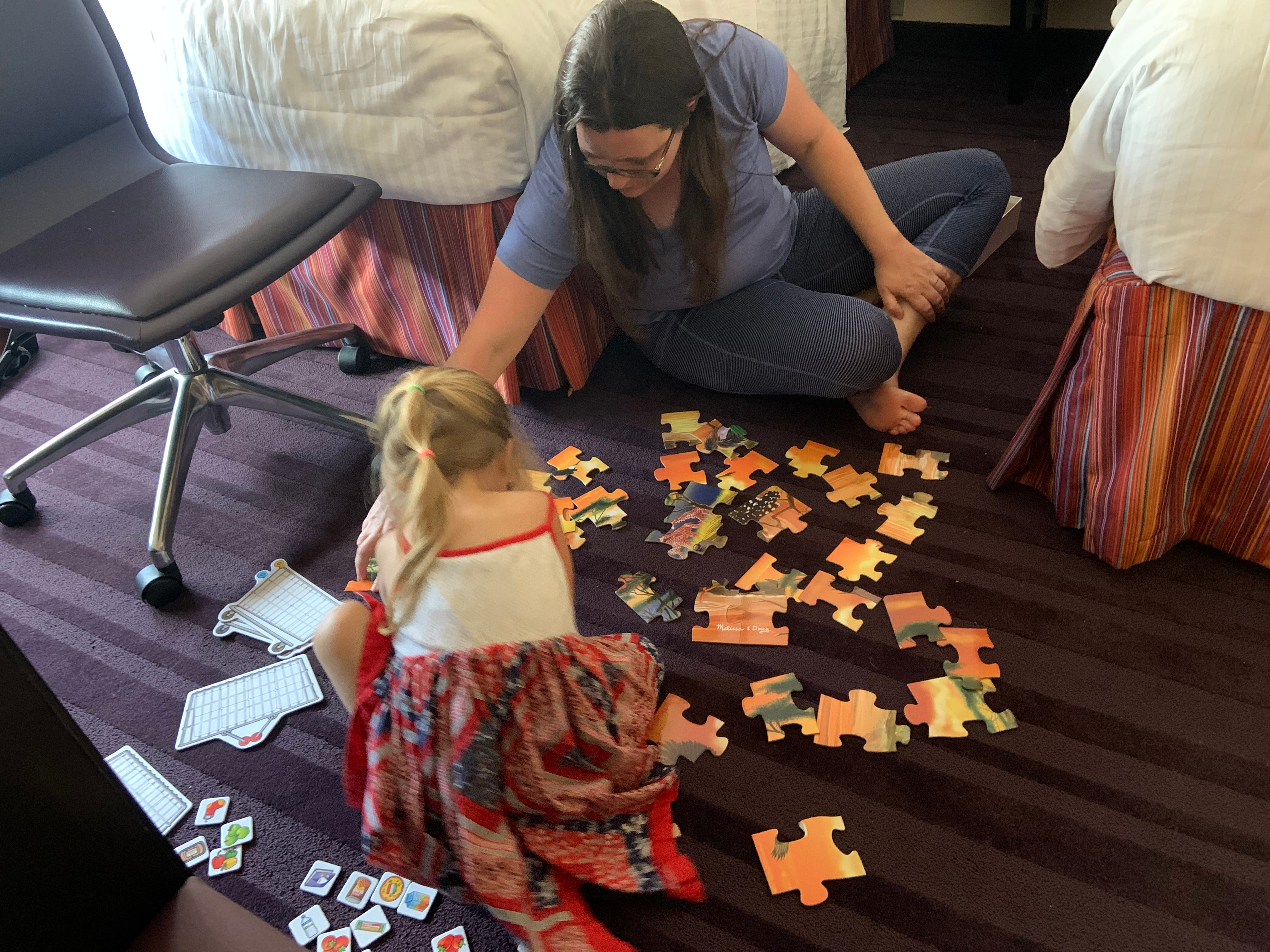 State Rep. Erin Zwiener, D-Driftwood, plays with her daughter, Lark, in their Washington hotel room on Wednesday, July 14, 2021.