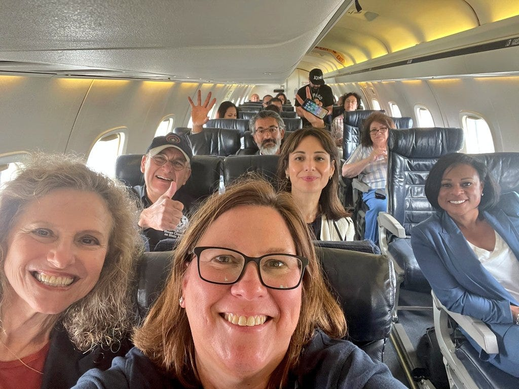 Rep. Julie Johnson, D-Farmers Branch, takes a selfie with her Democratic colleagues on their charter plane bound for Washington, D.C. on Monday, July 12.