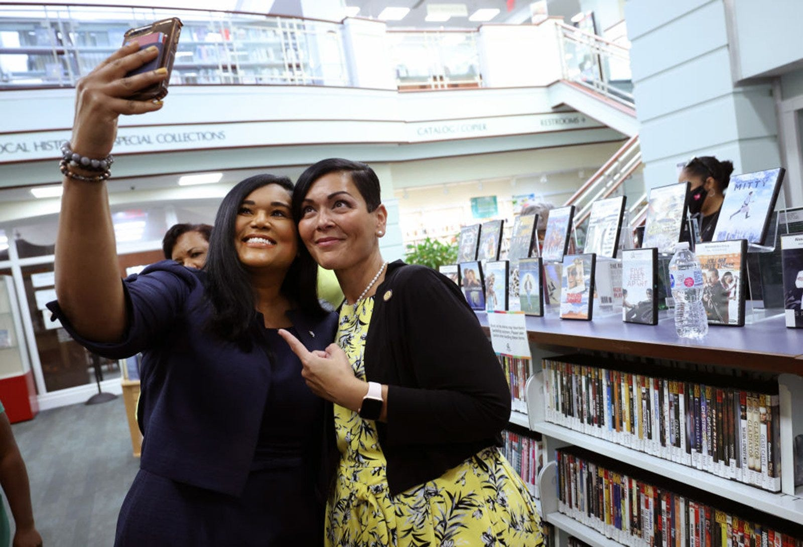 State Rep. Shawn Thierry, D-Houston, takes a photo with Hala Ayala, the Democratic nominee for Virginia lieutenant governor, on July 16 as they visit the Kate Waller Barrett Branch Library. It is the site of the 1939 Alexandria Library sit-in, where five Black men were arrested for attempting to register for a library card in Alexandria, Va.