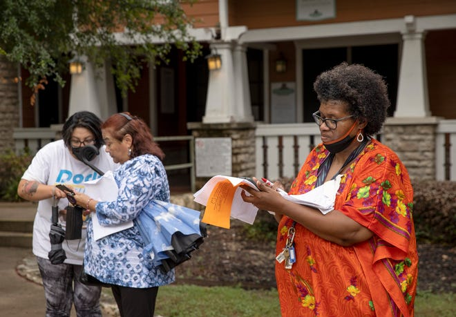 Maria Romero, left to right, Rosemary Sepeda and Kecia Prince wait outside the leasing office at Rosemont at Oak Valley Apartments on Tuesday July 6, 2021, after they received on Friday a notice to vacate their apartments within a month due to damage from the February freeze.   Several residents waited outside the office Tuesday morning to ask questions of management but no one came out to talk to them.