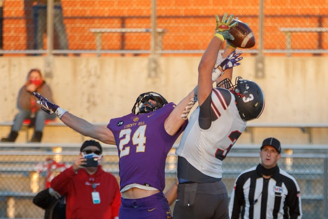 Liberty Hill defensive back Carter Hudson, left, defends a pass intended for Sharyland Pioneer's Mike Ramos Jr during the first quarter at the Class 5A Division II Region IV title game last season. Hudson had six interceptions a year ago while earning first-team, all-district honors in 2020.