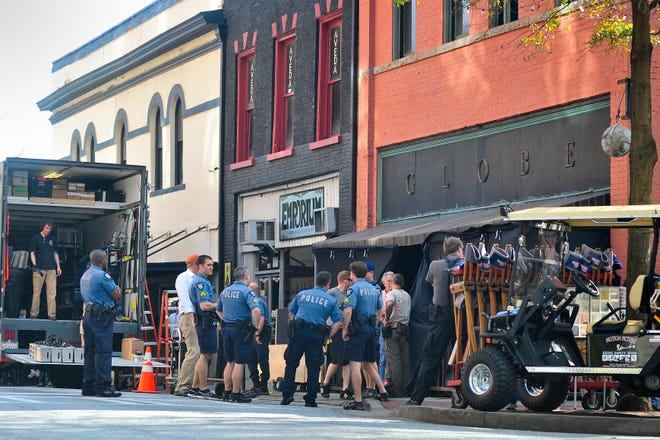 """Athens-Clarke police and the crew from Clint Eastwood's """"Trouble with the Curve"""" prepare the Globe in downtown Athens for filming in March 2012. (AJ Reynolds/Staff andrew.reynolds@onlineathens.com)"""