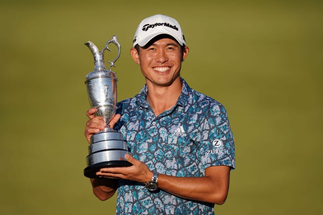 Jul 18, 2021; Sandwich, England, GBR; Collin Morikawa celebrates with the Claret Jug on the 18th green following his final round winning the Open Championship golf tournament. Mandatory Credit: Peter van den Berg-USA TODAY Sports