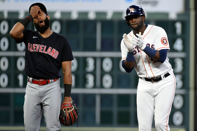 Houston Astros designated hitter Yordan Alvarez, right, reacts after hitting a two-run double, next to Cleveland shortstop Amed Rosario during the fifth inning of the Astros' 9-3 win Tuesday night. [Eric Christian Smith/Associated Press]