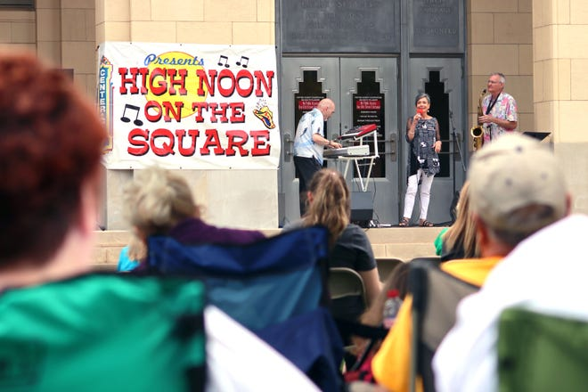 The group Polk Street Jazz, consisting of Jim Gardener, Sandy Storey and Doug Storey, perform during High Noon on the Square Wednesday afternoon on the lawn of the Potter County Courthouse.