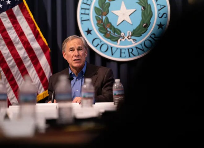 Gov. Greg Abbott holds a border security briefing with sheriffs from border communities at the Texas Capitol on July 10. Abbott says he will not impose another statewide mask mandate, despite COVID-19 cases being on the rise again.