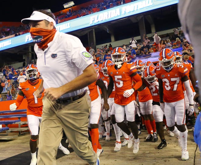 Florida head coach Dan Mullen leads his players out of the tunnel of Ben Hill Griffin Stadium in Gainesville, Fla. ahead of last year's game against Arkansas. His Gators went on to face Alabama in the SEC championship game.