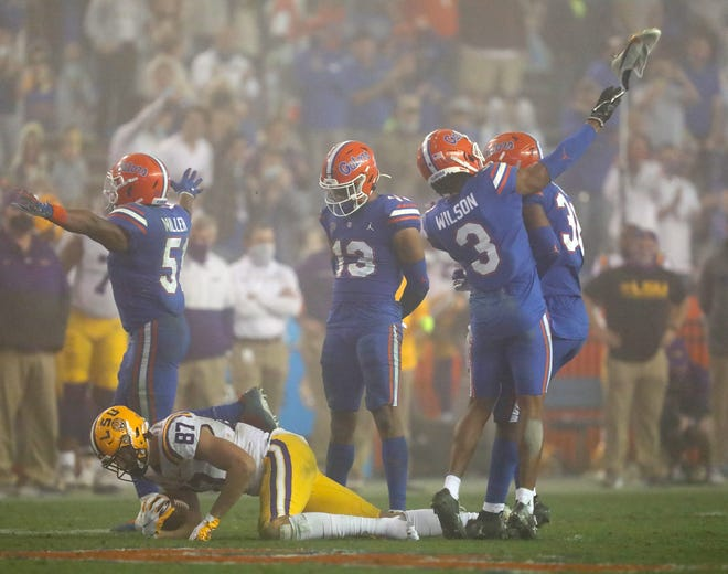 In one of the most memorable plays of last year's college football season, Florida defensive back Marco Wilson, right, throws the shoe of LSU tight end Kole Taylor. It resulted in a personal foul penalty. The Gators lost at home, 37-34.