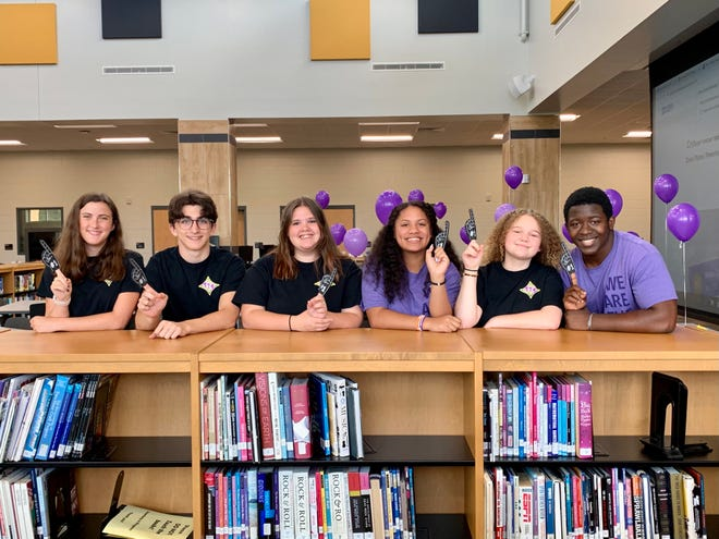 North Augusta High School Student 2 Student members Rebecca Noyce (from left), Bennett Merion, Liberty King, Alexus Hutchinson, Cheyenne Wieczorek and Emmanuel Coulibaly celebrate their team's being named the National S2S High School Team of the Year.