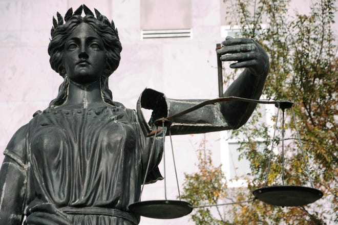 The Lady Justice statue at the Municipal Building, before it was moved to the new courthouse.