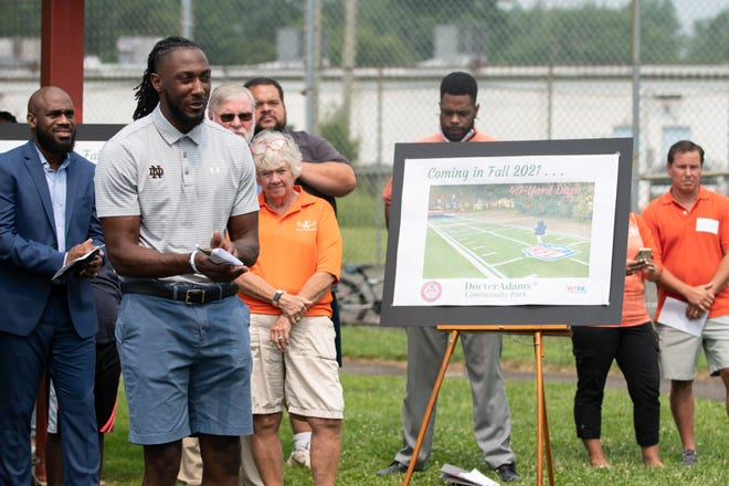 New York Jets running back and Central Bucks South alum Josh Adams listens as opening remarks are delivered during a groundbreaking ceremony at DocterAdams Community Park in Warrington on Wednesday. Adams spearheaded the project to enhance the existing park, known as Willow Knoll, where he had spent much of his childhood.