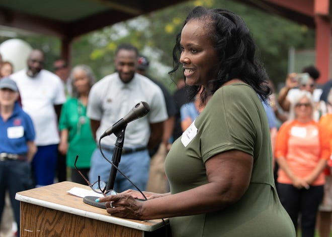 Apryll Adams, manager and mother of Josh Adams, speaks about her son's determination to give back to his community during a groundbreaking ceremony at DocterAdams Community Park in Warrington on Wednesday.