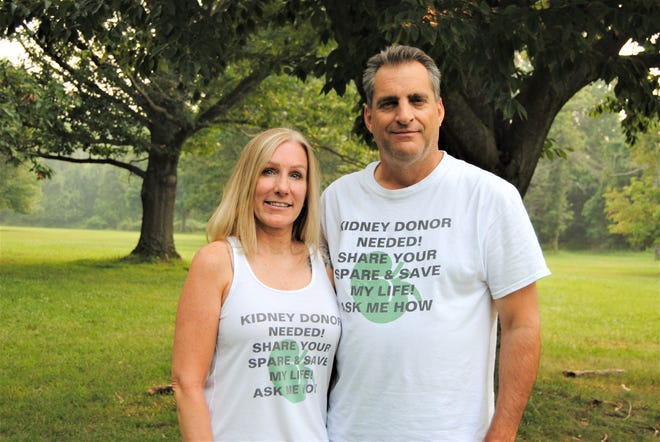"""Joe Fitch, 55, and his fiancée, Wendy Cornell, wear shirts that read, """"Kidney donor needed! Share your spare and save my life!"""" The message is part of their efforts to find Fitch a living donor as soon as possible."""