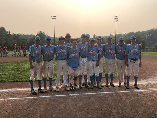 Hopewell's American Legion baseball team smiles with their silver medals following a loss to Uniontown in the Region 6 championship game on Tuesday, July 20.