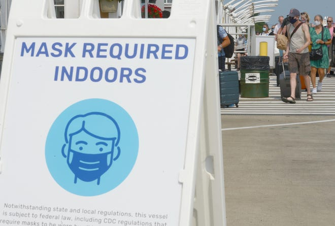 Masks are required as passengers head to the Boston-bound fast ferry on MacMillan Wharf in Provincetown on Wednesday. (Steve Heaslip/Cape Cod Times)
