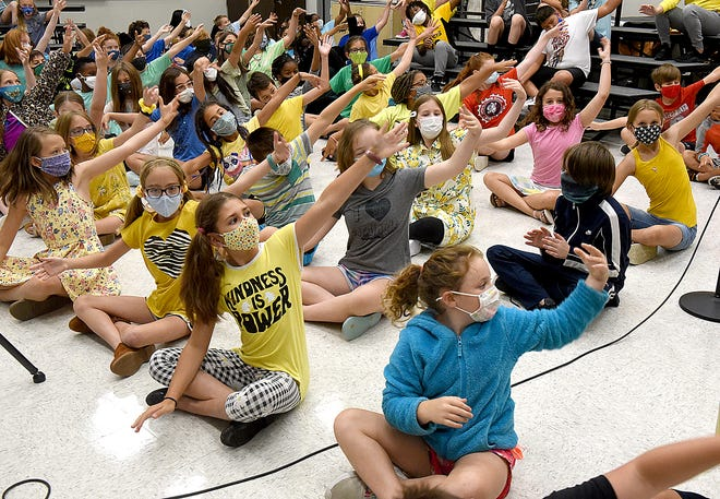 Elementary students practice during a choir class Wednesday at Gentry Middle School. The students are part of the Columbia Public Schools Summer Fine Arts Explorer program.